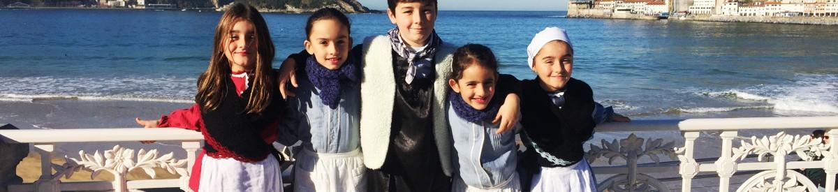 A group of children at la Concha Bay